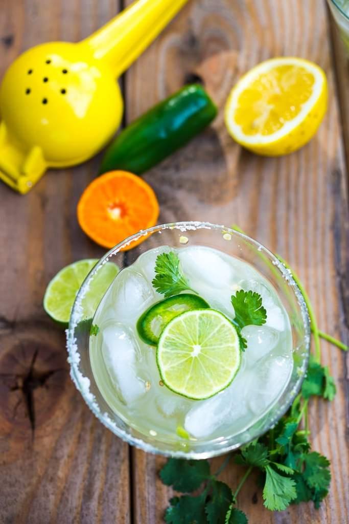 Smokey Spicy Mezcal Margarita w/ jalapeno and cilantro...a refreshing twist!   www.feastingathome.com