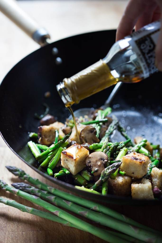 Wok Seared Aspargus, Mushrooms and crispy tofu with ginger and sesame...a vegan gluten free meal that can be made in 15 minutes flat!| www.feastingathome.com
