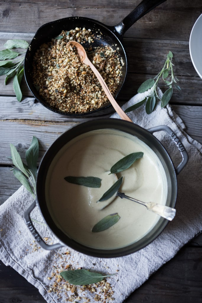 A simple delicious recipe for Velvety Cauliflower Leek Soup with Sage & Toasted Pine Nut Crumble | www.feastingathome.com