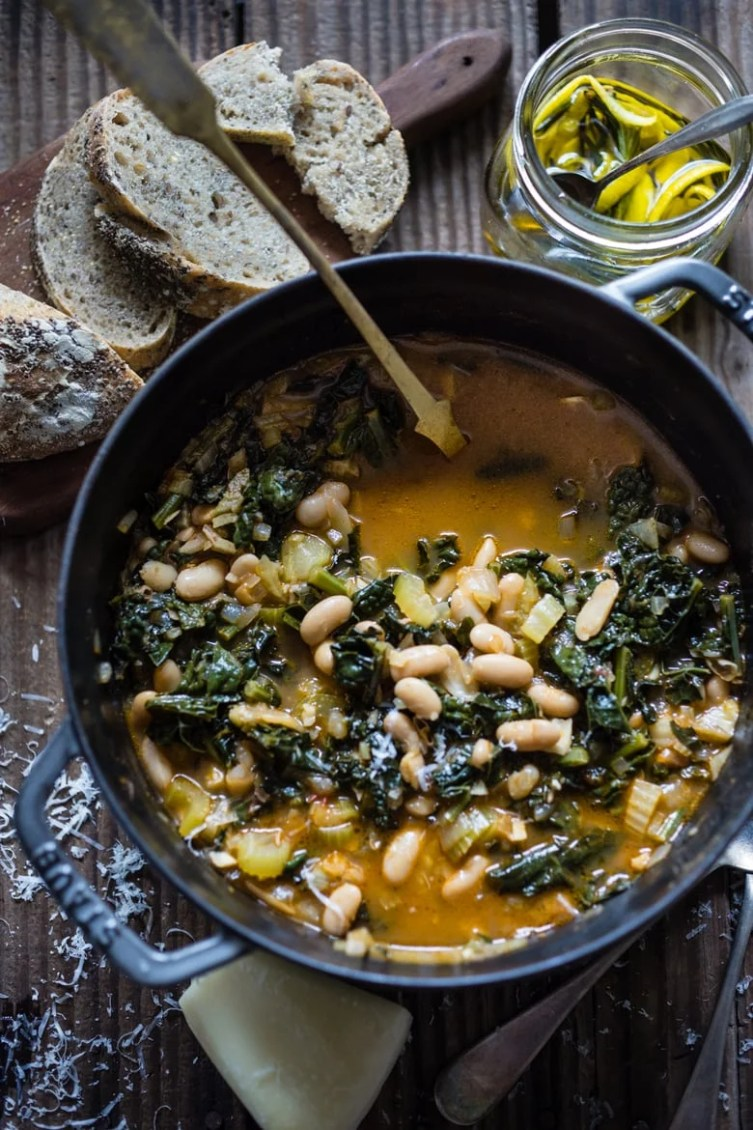 Cozy Fall Soups to Savor Now -this flavorful hearty stew from Tuscany, is called Ribollita with Cannellini beans, lacinato kale, and vegetables, served with crusty bread, drizzled with a Lemon Rosemary Garlic Oil. | www.feastingathome.com