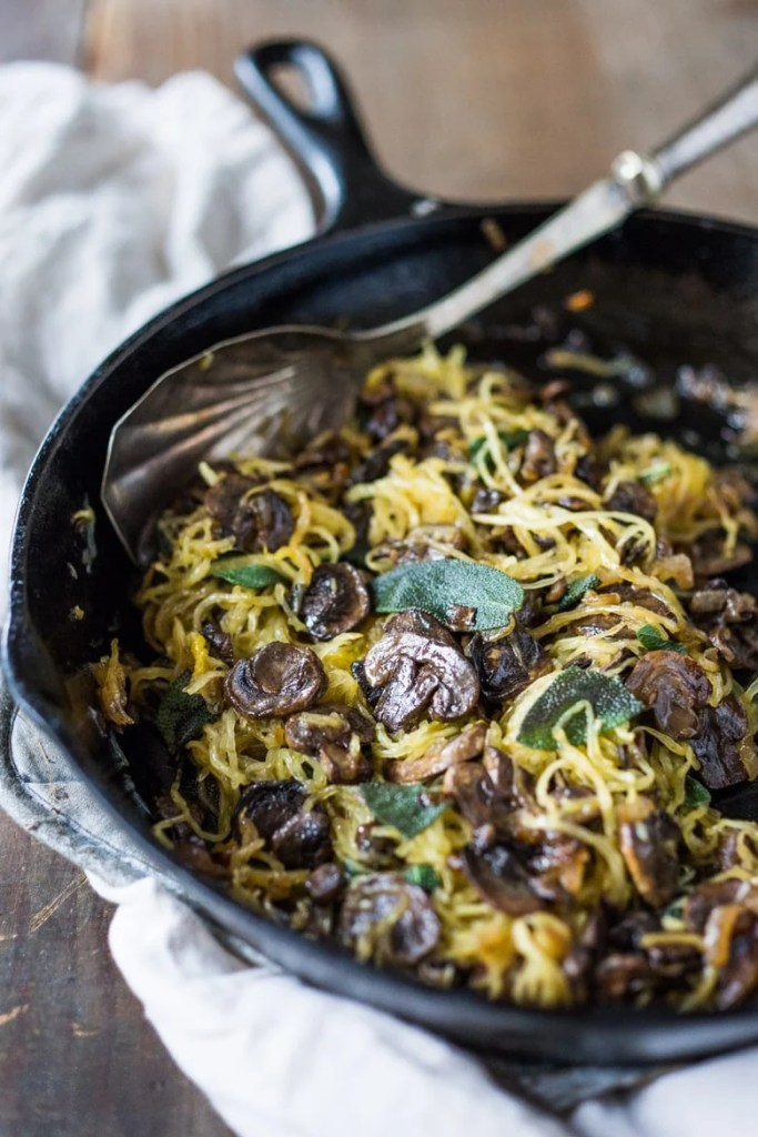Roasted Spaghetti Squash with mushrooms, garlic and sage- a flavorful side dish, perfect for fall. Keep it vegan or add grated Romano cheese| www.feastingathome.com