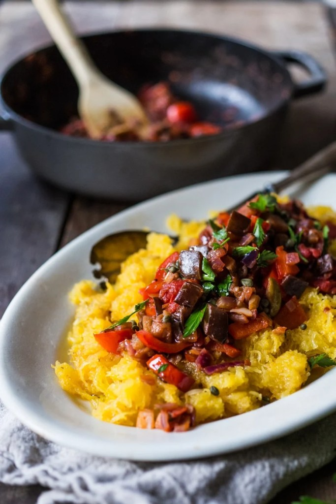 This robust and flavorful recipe for Roasted Spaghetti Squash with Eggplant Puttanesca, is healthy and gluten free! Easy and simple. | www.feastingathome.com