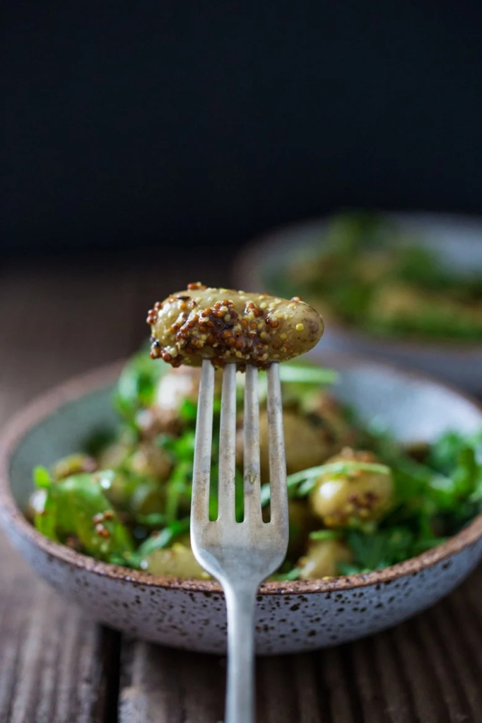 This Warm Potato Salad with Mustard Seed Dressing, cornishons (baby pickles) and baby arugula is a healthy, simple and lightway to serve up your favorite root vegetable! Serve it w/ Salmon for a light dinner or chopped chicken breast for a satisfying lunch!   www.feastingathome.com