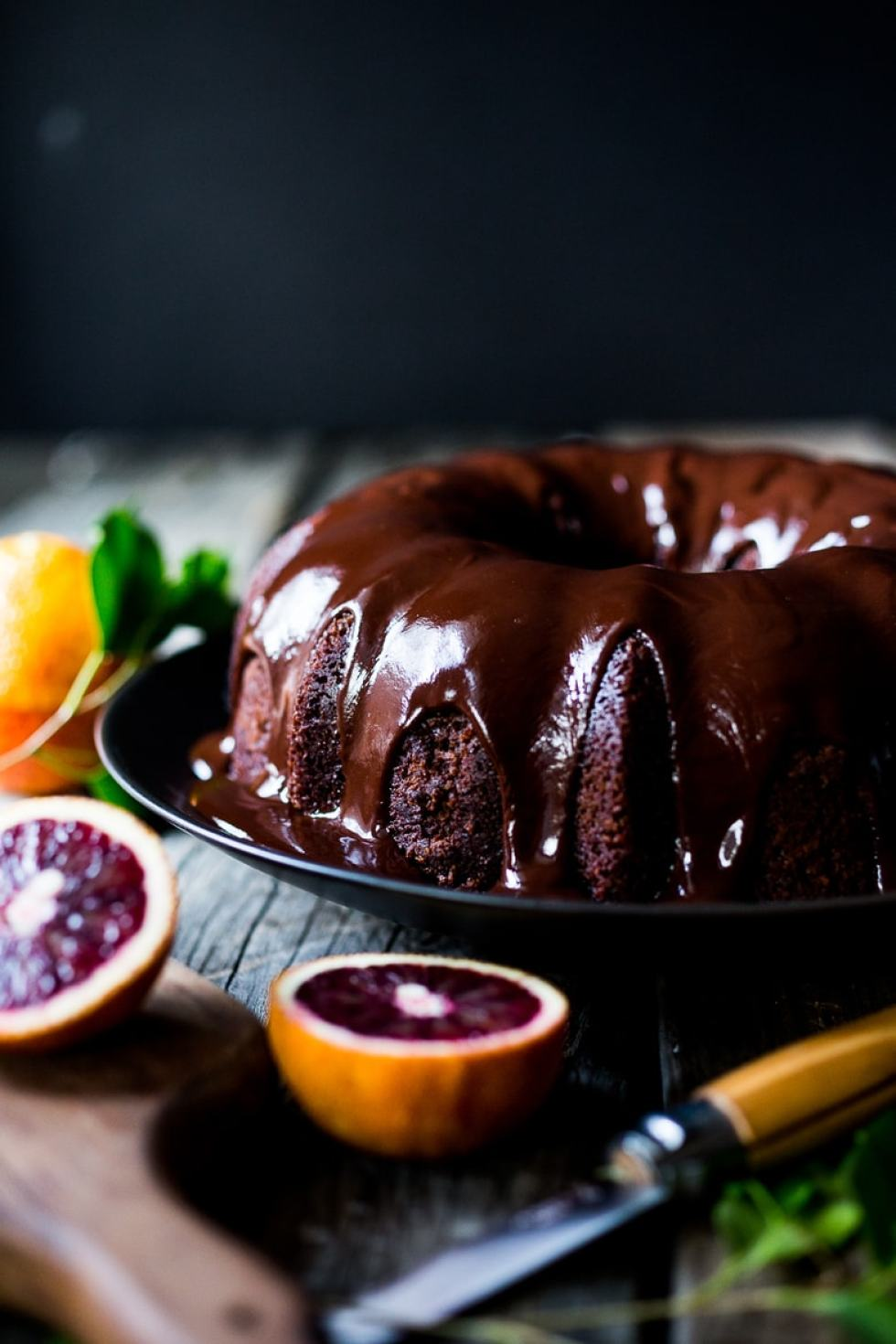 A delicious recipe for Dark Chocolate Bundt Cake with Blood Oranges and a Chocolate Ganache icing. Simple and scrumptious! | www.feastingathome.com