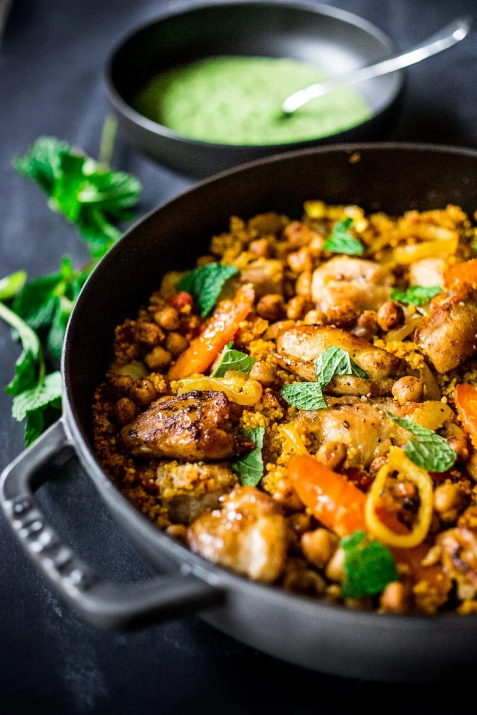 Delicious Tunisian Chicken ( or chickpeas) with Carrots, Cous Cous and flavorful Green Harissa Yogurt Sauce. A one-pot meal that can be made in 45 mins | www.feastingathome.com #tunisian #chicken #chickpeas #couscous