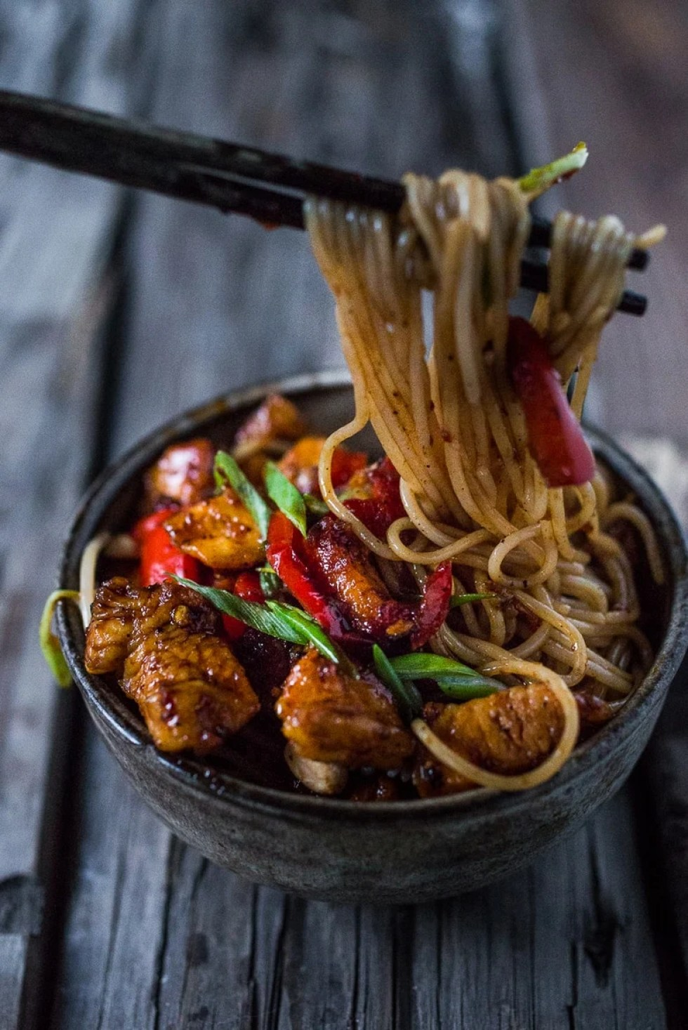 Kung Pao Noodles with chicken or roasted cauliflower served over noodles. | www.feastingathome.com