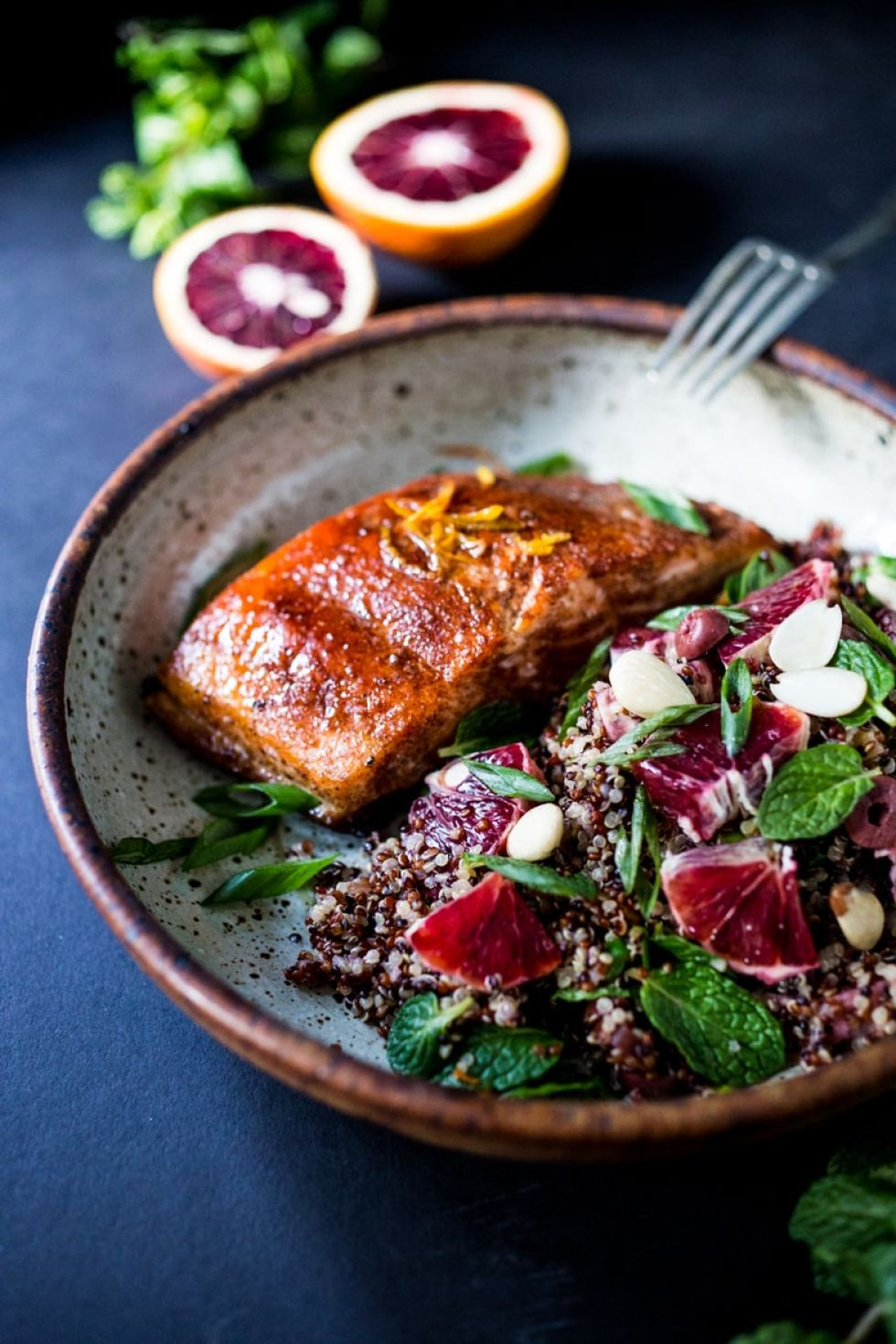 A simple Moroccan Quinoa Salad with blood oranges, almonds, olives, mint and a blood orange dressing. Pair this with Moroccan Salmon for a quick healthy meal.   www.feastingathome.com