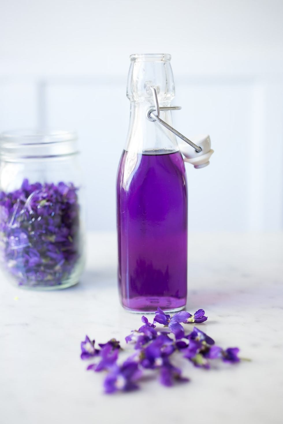 An easy recipe for Violet Simple Syrup- lovely in cocktails like a Violet infused French 75 - perfect for Mothers Day, Bridal Showers or Weddings. Romantic, floral, feminine. | www.feastingathome.com