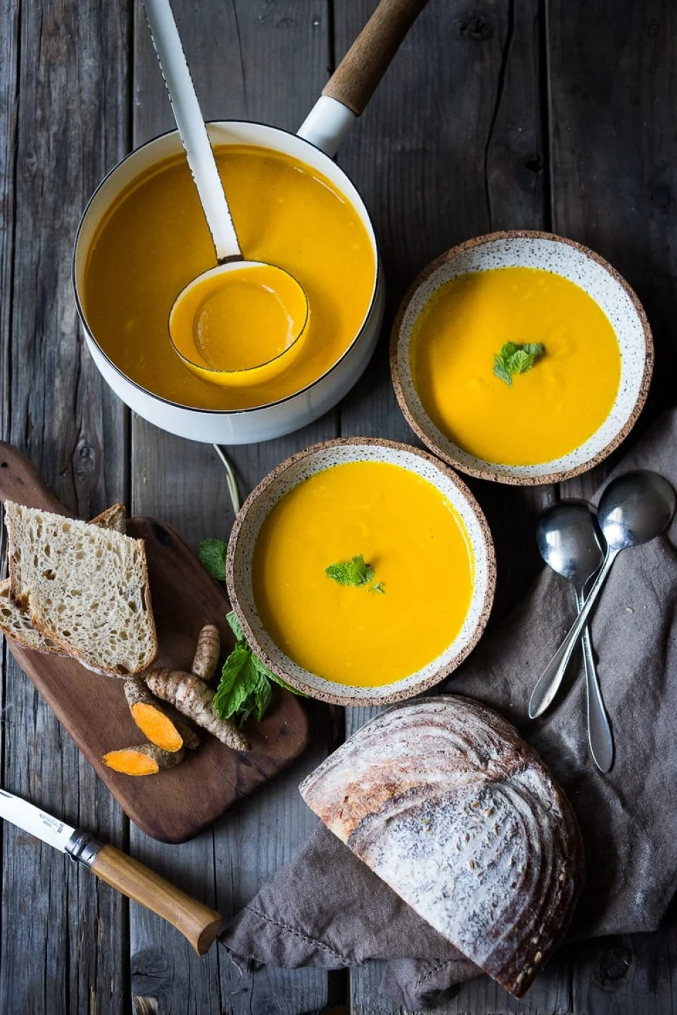 10 Simple Powerful Turmeric Recipes to Heal, Sooth and Protect | Add fresh turmeric to soups, like this Glowing Carrot, turmeric and ginger soup. | www.feastingathome.com