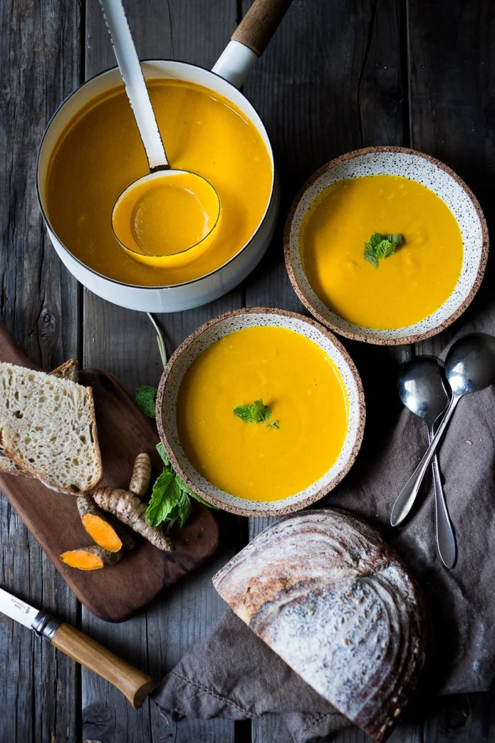Cozy Fall Soups to Savor Now -Creamy Carrot Turmeric Soup with Coconut Milk and ginger. Fresh turmeric and mint gives this soup its exotic flavor. Vegan. | www.feastingathome.com