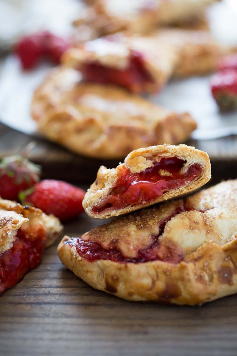 These little Strawberry Hand Pies, or Strawberry Turnovers if you prefer --are like summer wrapped up in buttery pie crust. They are packable and transportable-- perfect for picnics and summer barbecues when you don't want to deal with dessert plates and forks. Simply pick them up and eat them.
