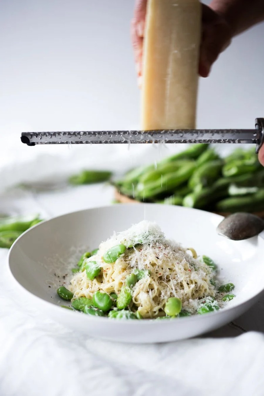 A simple delicious recipe for Cacio e Pepe with Fava Beans (Pasta with fava beans, cheese and pepper) is so tasty you will want to make it over and over. No fava beans? Substitute peas or edamame! | www.feastingathome.com