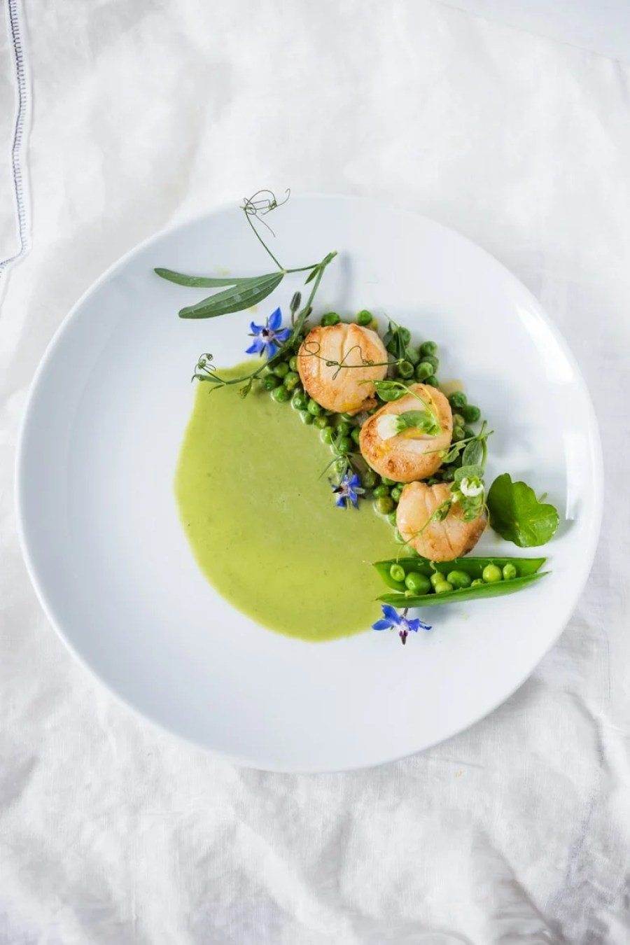 Seared Scallops with Spring Peas, Tarragon and Truffle Oil