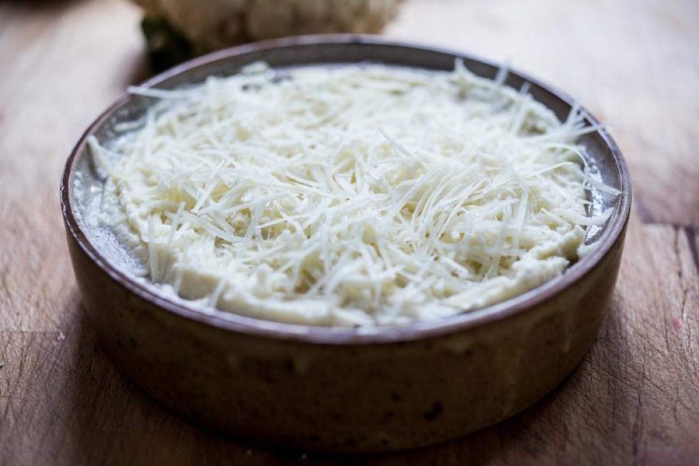 Baked Cauliflower Mash with roasted garlic - a tasty alternative to mashed potatoes | www.feastingathome.com