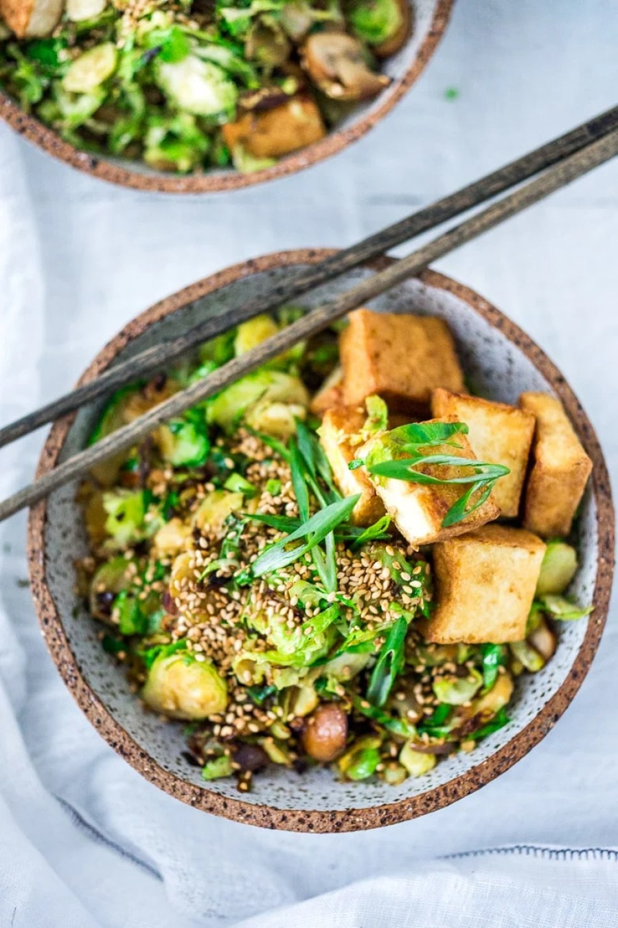 Detoxing Sesame Brussel Sprouts and Tofu Bowl- with mushrooms, scallions and toasted sesame seeds. Vegan and Gluten-free. | www.feastingathome.com