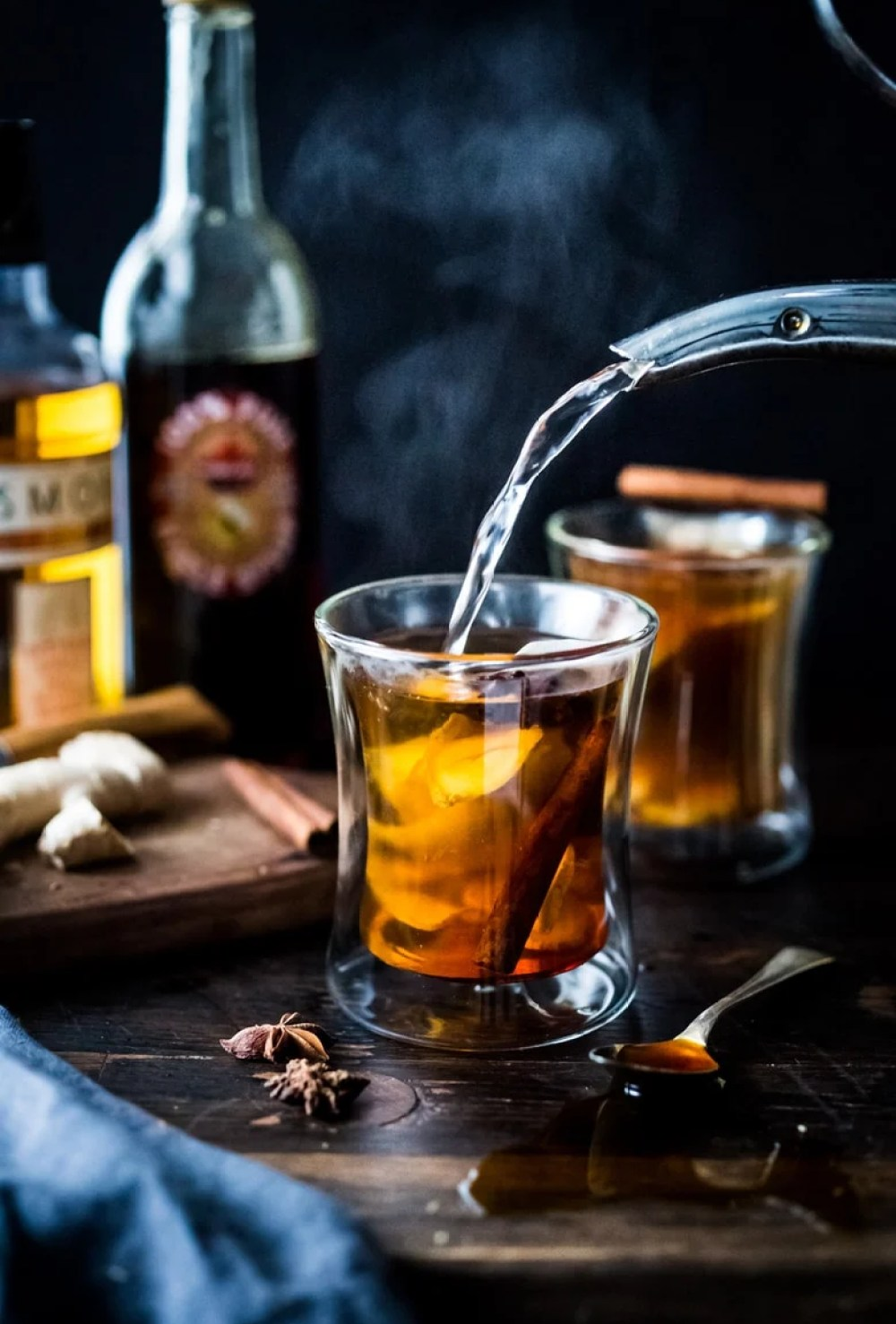 Maple Ginger Hot Toddy- made with whiskey, hot water, muddled ginger, whole spices and lemon- this winter sipper soothes a sore throat and warms the body. | www.feastingathome.com