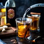 Maple Ginger Hot Toddy- made with whiskey, hot water, muddled ginger, whole spices and lemon- this winter sipper soothes a sore throat and warms the body.   www.feastingathome.com