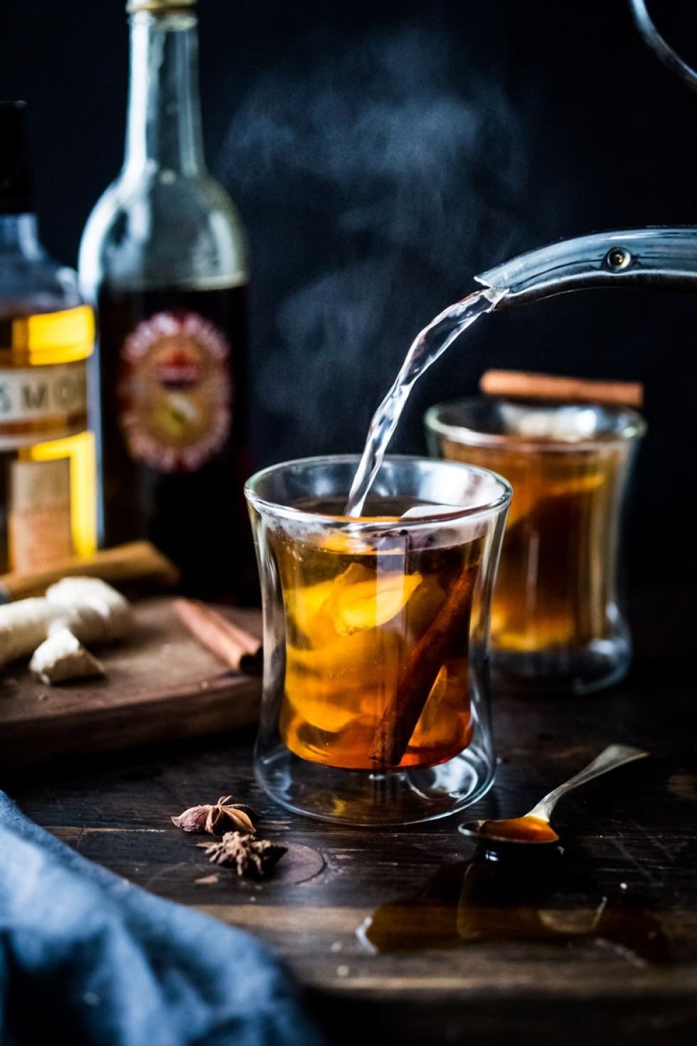 Maple Ginger Hot Toddy- made with whiskey, ginger tea, hot water, muddled ginger, maple or honey, whole spices and a squeeze of lemon- soothes a sore throat and warms the body. | www.feastingathome.com #celestialseasonings #themagicoftea
