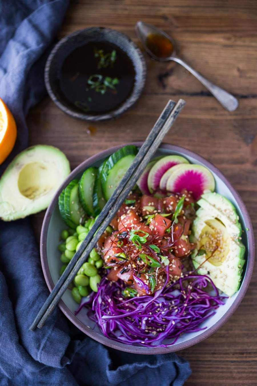 Healthy Poke Bowl- made with ahi tuna (or TOFU!) served over brown rice or kelp noodles, with avocado, cucumber, radish and Citrus Ponzu Sauce! | www.feastingathome.com