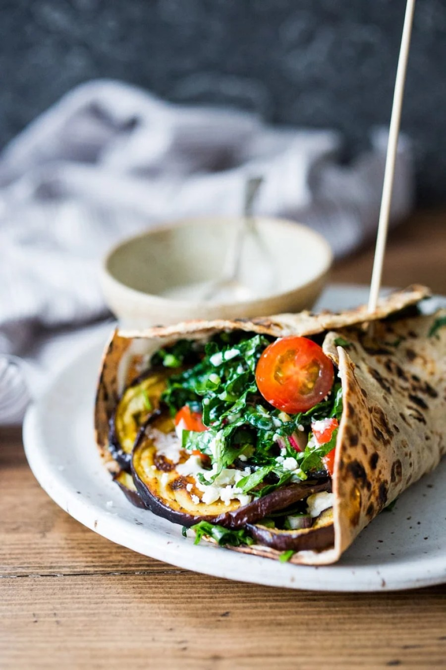 10 Plant Based Clean Eating Recipes like this Grilled Eggplant Wrap with Kale Parsley Slaw and Tahini Sauce | www.feastingathome.com
