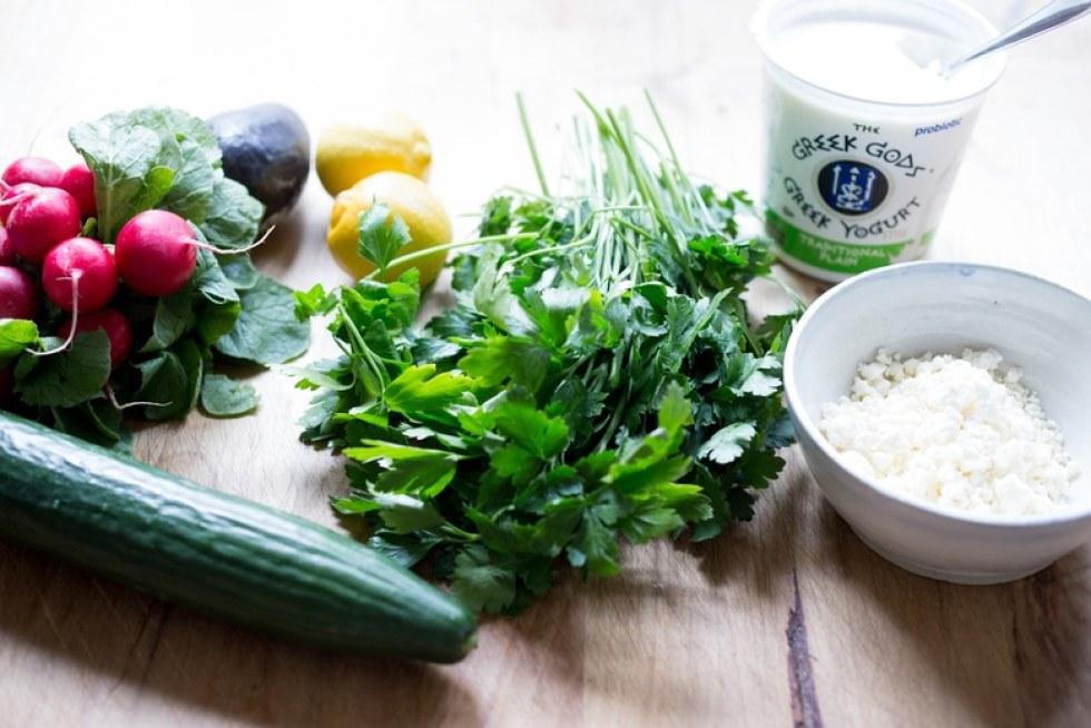 Greek lamb Tacos with Minted Yogurt Sauce, cucumber, radish, feta and an herb-caper drizzle- a feast for the senses! | www.feastingathome.com