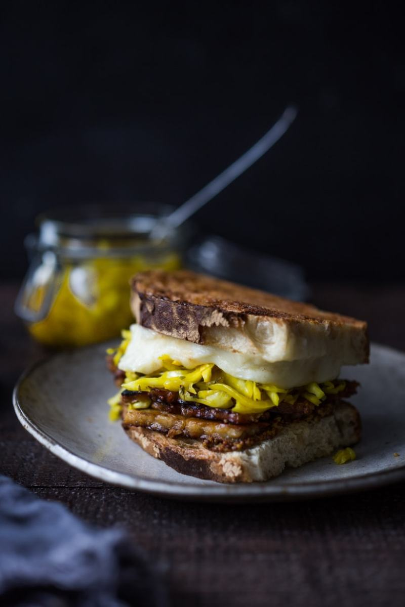 Tempeh Reuben Sandwich with Smoked Mozzarella and Turmeric Sauerkraut ( or sub regular!). A tasty, hearty, delicious vegetarian sandwich! | www.feastingathome.com