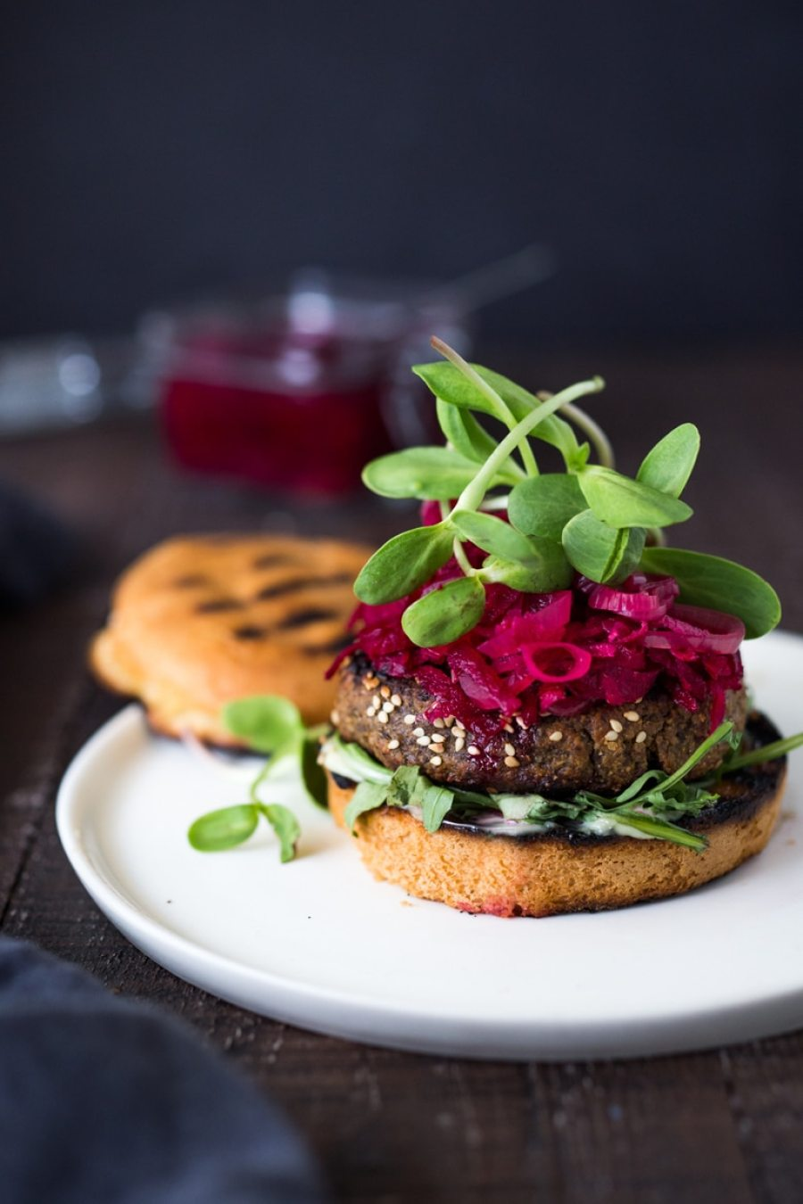 Sprouted Lentil Burgers- grillable, vegan and gluten-free adaptable. Super healthy and delicious, packed with living nutrients! Topped with quick picked beets. | www.feastingathome.com