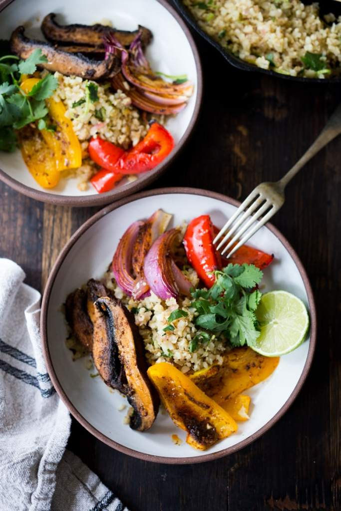 Veggie Fajita Bowl with Cilantro Cauliflower Rice- a filling, low calorie meal that is vegan & gluten-free and only takes 15 minutes of hands-on time! Keep it vegan or add chicken. | www.feastingathome.com