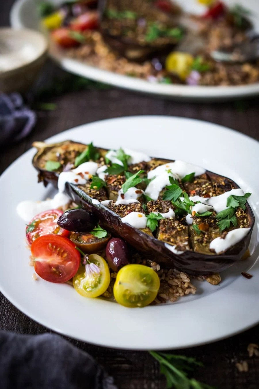 Crosshatched Zataar Roasted Eggplant served over rice or grains with lemony tahini sauce, plain yogurt or tzatzki sauce. Vegan, Gluten-free! | www.feastingathome.com
