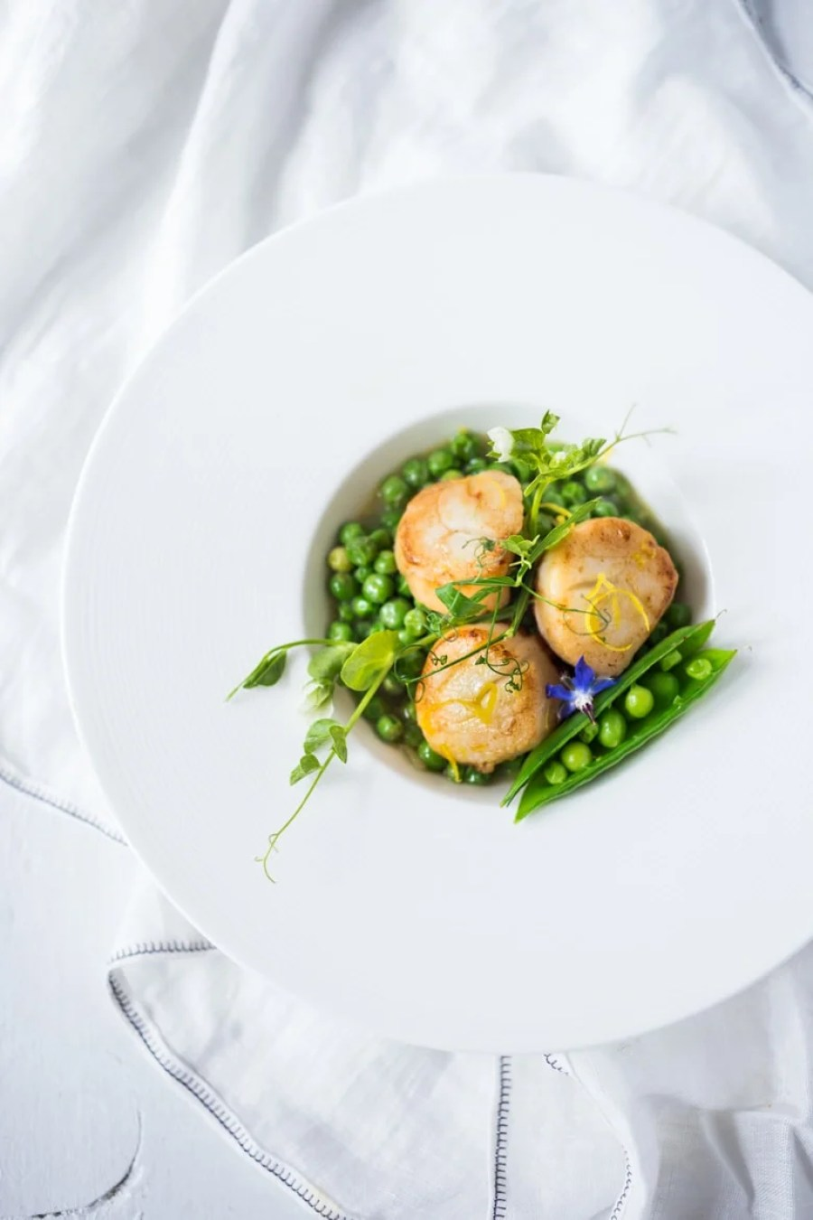 Seared Scallops with Spring peas, tarragon and truffle oil- a light and elegant meal, perfect for entertaining or special occasions.   www.feastingathome.com