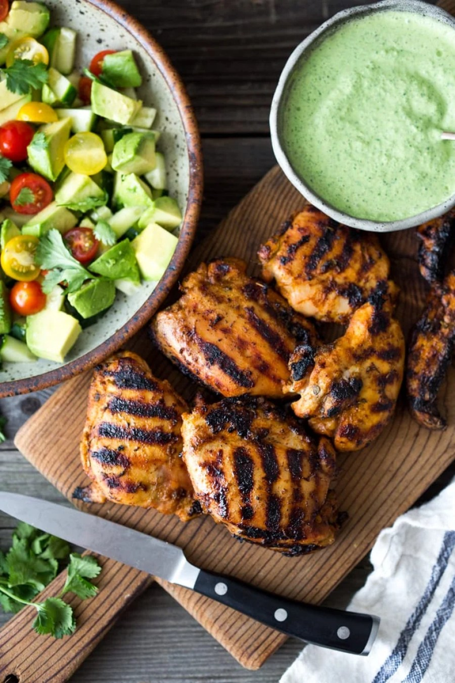 Simple, delicious Grilled Peruvian Chicken (Pollo a la Brasa) with spicy Green Sauce and an Avocado Tomato Cucumber Salad. Can be made in 40 minutes- perfect for weeknights!