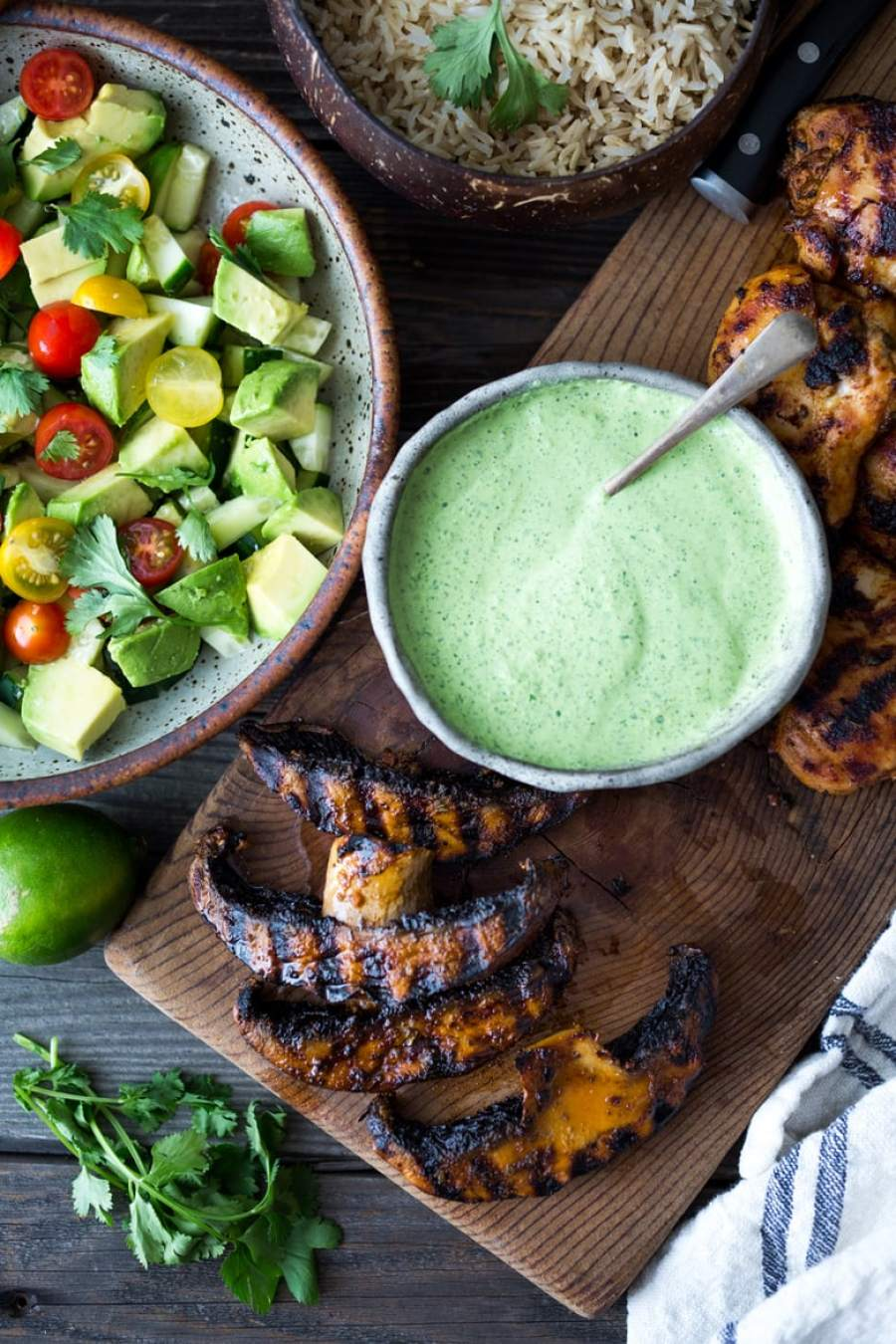 Simple, delicious Grilled Peruvian Portobellos with Green Sauce and an Avocado Tomato Cucumber Salad. Can be made in 40 minutes- perfect for weeknights!