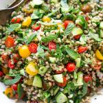 Farro Tabbouleh Salad with tomatoes, cucumber, fresh herbs and a simple lemon dressing.   www.feastingathome.com