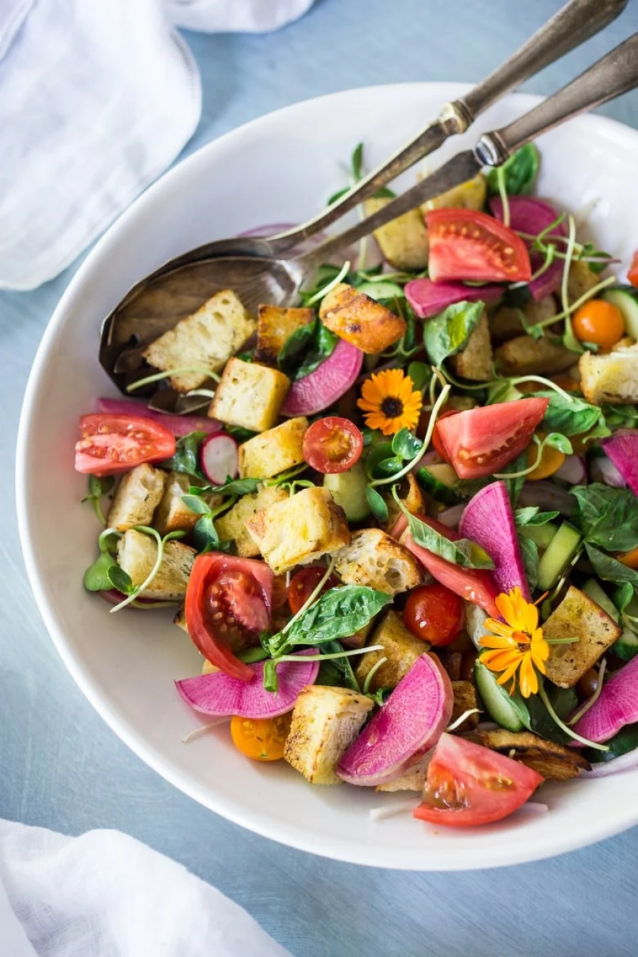 The BEST EVER Summer Panzanella Salad with Garlicky Croutons, bursting with fresh seasonal summer ingredients and FLAVOR! | www.feastingathome.com