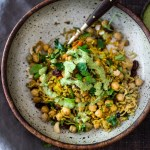 Quick Chickpea Biryani w/ Cilantro Yogurt Sauce. A fragrant rice dish infused went Indian spices - vegan and gluten-free. A quick and easy weeknight meal. | www.feastingathome.com