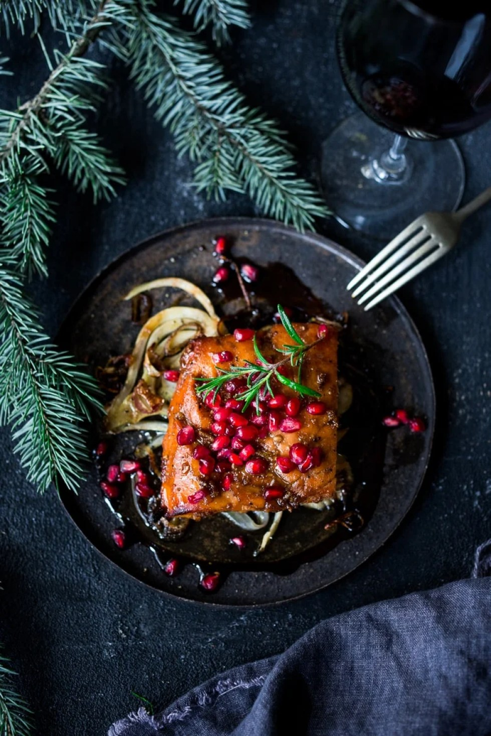 Roasted Pomegranate Salmon with braised fennel - a healthy and festive holiday dinner that can be made in under 30 minutes. | www.feastingathome.com