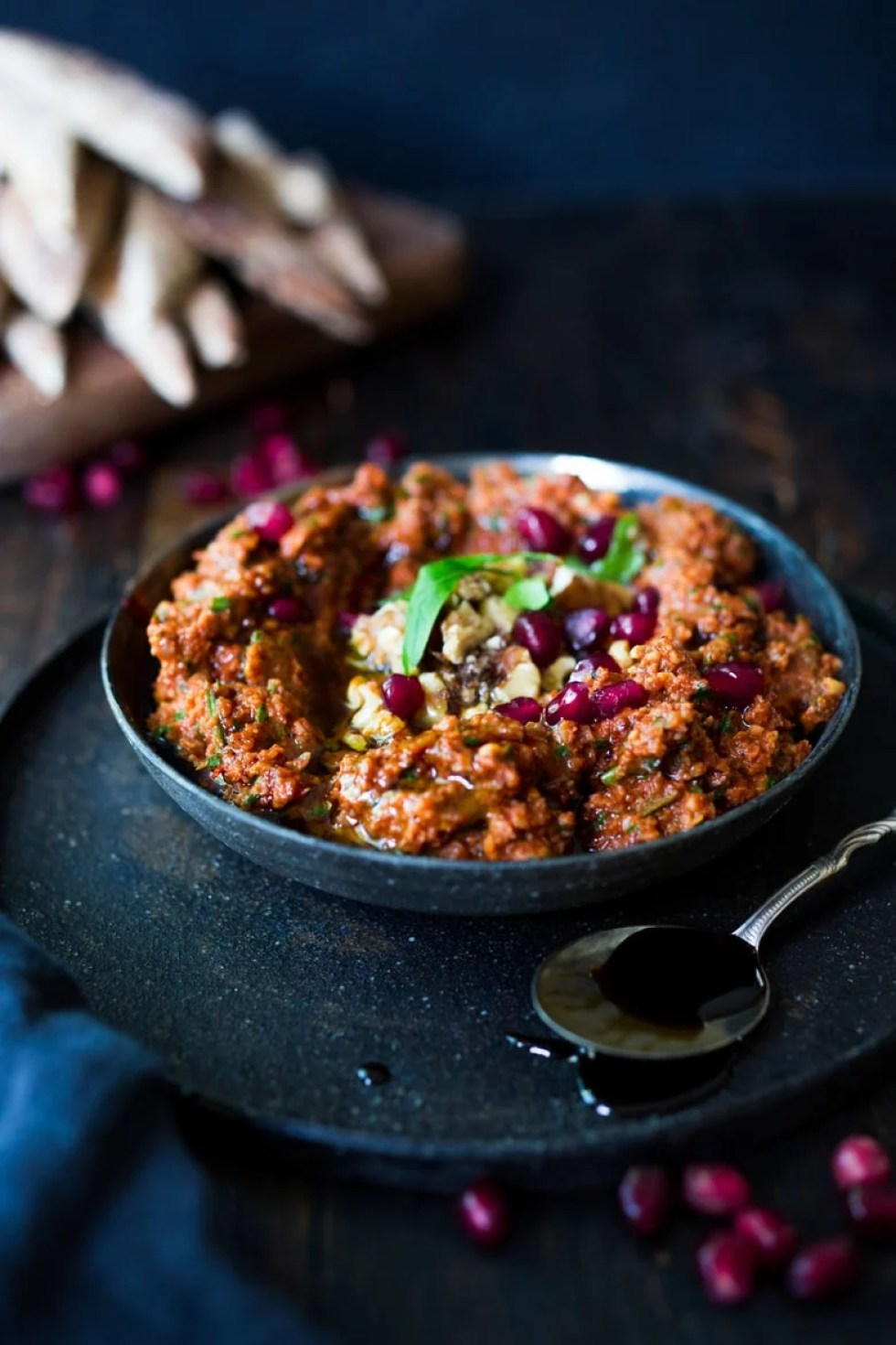 Muhummara Dip - a simple flavorful Middle Eastern Roasted Pepper & Walnut Dip that can be made ahead in food processor. Perfect for parties and gatherings, serve with toasted pita or crackers.   www.feastingathome.com