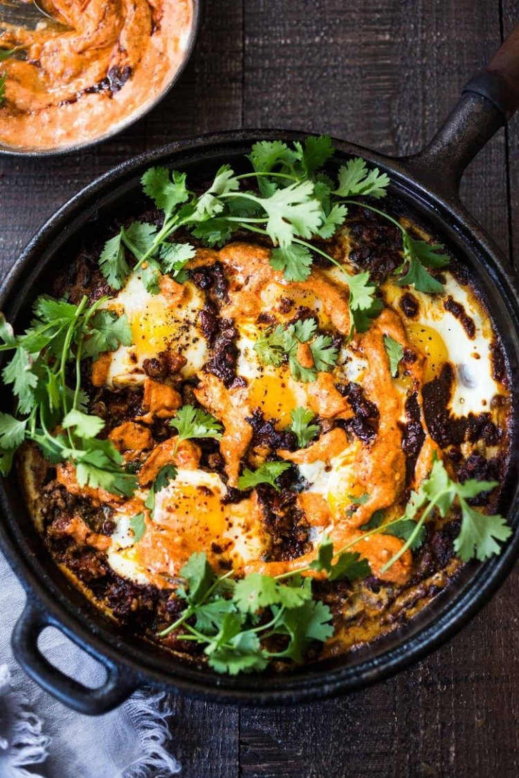 Eggs baked in a moroccan lamb stew- moroccan Eggs with Harissa yogurt