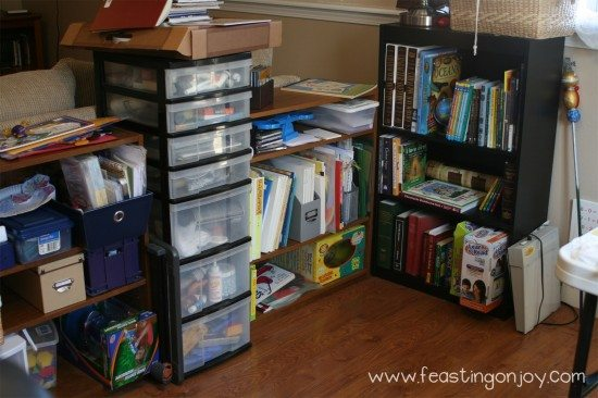 Unorganized school room shelve before makeover