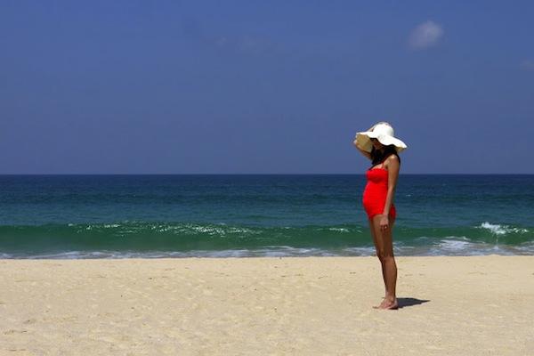 On the beach, gorgeous pregnant (at the time) Alexa