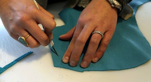 Beatrice working with leather, image via SF Gate/Chronicle