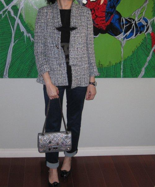 Wearing Chanel jacket, sweater, bag