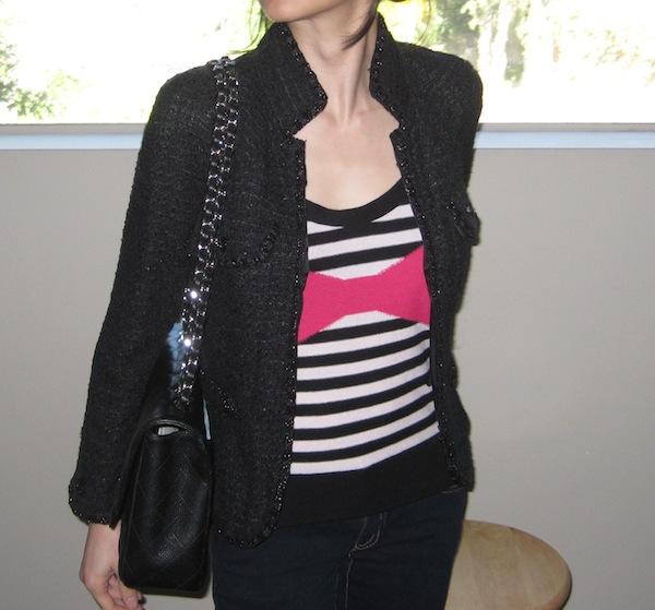 Wearing a Chanel jacket
