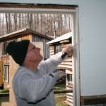 Harold works on chiseling out the mortice in the new door frame