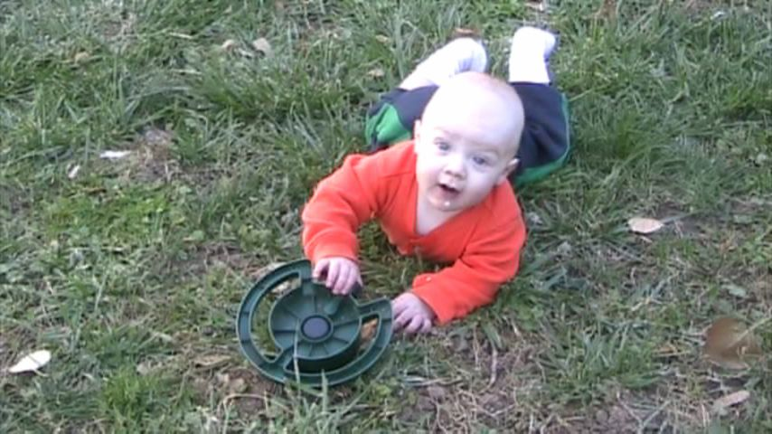 Spencer playing with the sprinkler
