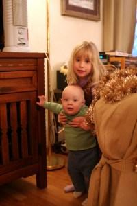 Isabelle helping Spencer walk