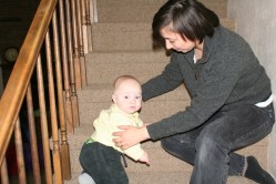 LIka helps Spencer climb down the stairs
