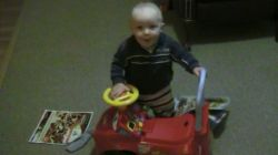 Spencer playing with his car