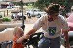 Spencer drives a golf cart at the Elkhorn Lodge