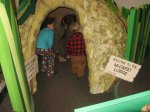Sadie, Rob,  and Spencer investigate the muskrat lodge at the nature center